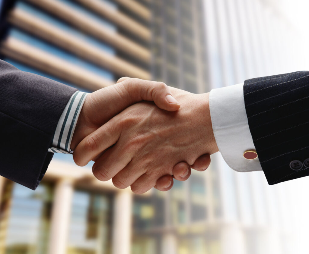 Connect with Us business men handshake